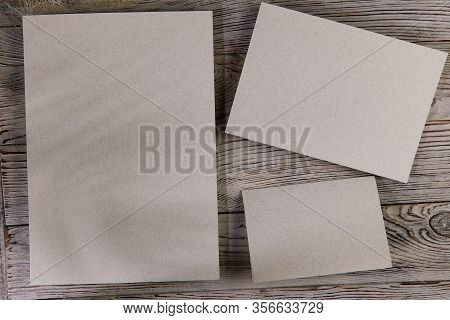Mosk Up. Abstract Background. Three Cards Of Different Sizes On A Wooden Surface. Texture Of Paper A