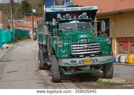 GUATAPE, COLOMBIA - CIRCA 2019: Old classic american GMC lorry in well kept condition clean and shiny on a street of Colombian town Guatape, Antioquia, travel destination