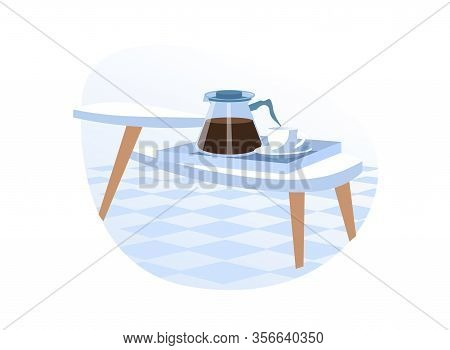 White Coffee Cup And Coffee Pot With Fresh, Aromatic, Just Made Hot Drink On White Table In Kitchen