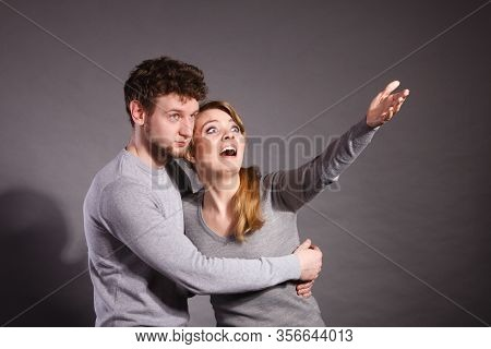 Fear And Scare. Two Young Terrified Scared People. Stressed Woman And Man Showing To Copy Space. Cou