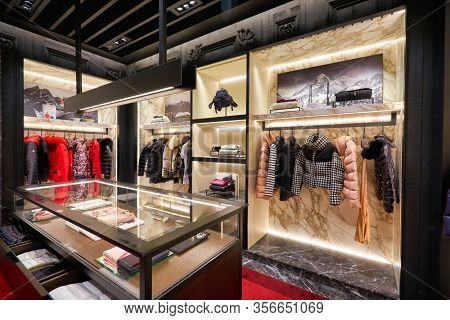 SINGAPORE - APRIL 21, 2019: clothes on display at Moncler store in Singapore Changi Airport. Moncler S.p.A is an apparel brand mostly known for its skiwear.