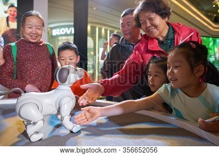 SHENZHEN, CHINA - CIRCA APRIL, 2019: people play with Sony's Aibo robot dog at Sony Expo 2019 at UpperHills Mall in Shenzhen, China.