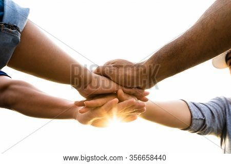 People Putting Their Hands Together. Friends With Stack Of Hands Showing Unity And Teamwork. Friends