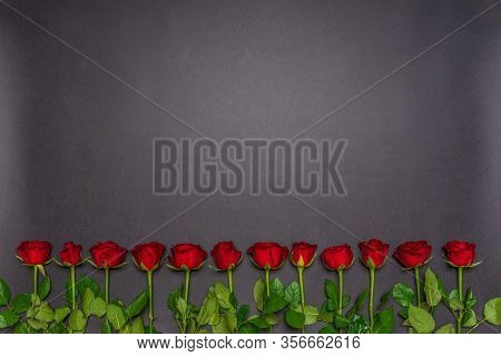 Border Made Of Fresh Red Rose Flowers On Black Background. Floral Composition, Mourning Card For Eve