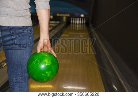 A Man Throws A Bowling Ball. Bowling. Close- Up Of A Man Holding A Bowling Ball, Focusing For A Thro