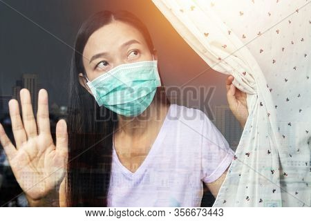 Home Quarantine Concept. Woman At Risk Of Being Infected With The Coronavirus Stay Isolation At Home