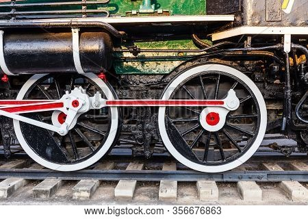 Old Train Wheels On Rails In Black, Red And White.