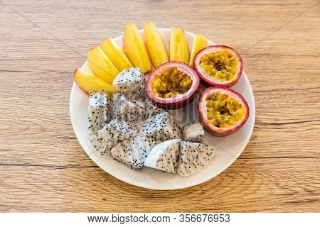 Passion Fruit, Dragon Fruit, Sliced Apples And Beautifully Arranged In A Ready-to-eat Rice Dish On A