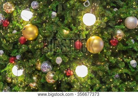 Christmas Lights Decorated With Balls On Tree In Celebration Christmas Festival. Select Focus