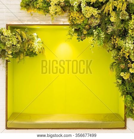 The Green Frame Has A Light Yellow Flower Arch On The White Wall. Use For Background Or Backdrop