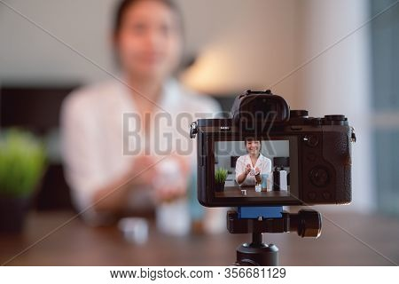 Young Asian Woman Beauty Vlogger Video Online Is Showing Make Up On Cosmetics Products And Live Vide