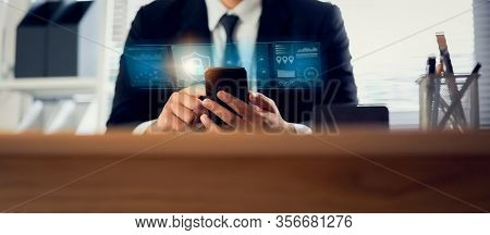 Technology Concept With Cyber Security Internet And Networking, Businessman Hand Working On Smartpho