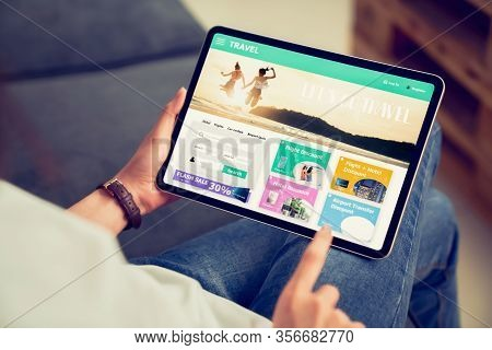Hands Holding Digital Tablet With Application Booking Flight Travel Search Ticket Holiday And Hotel