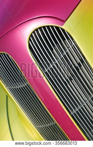 Magenta And Lime Vehicle Panels And Engine Grille Closeup