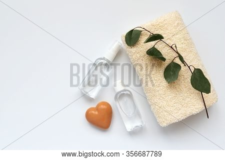 Set Of Antiseptic Items. Bottles Of Antiseptic Hand Gel And Spray, Soap And Towel Decorated Leaves O
