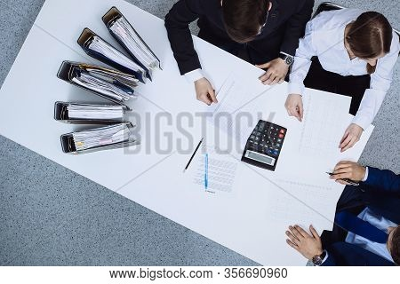 Business People At Meeting, View From Above. Bookkeeper Or Financial Inspector Making Report, Calcul
