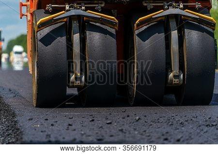 Road Roller Flattening New Asphalt. Heavy Vibration Roller At Work Paving Asphalt, Road Repairing. S
