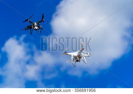 Modern Technological Shipment Innovation. Drone Fast Delivery Concept, Two Multicopters Flying In Th