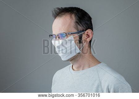 Adult Man Wearing Hygienic Mask To Prevent Infection, Airborne Respiratory Illness Such As Flu, 2019