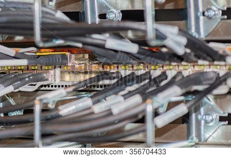Network Switch Connected With Network Cable Rj45 Patch Cable And Fiber Optic Cable In A Data Center