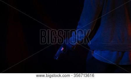 Man Holding A Gun In Hand, The Ship Ready To Shoot The Man Pointed A Gun,black Background