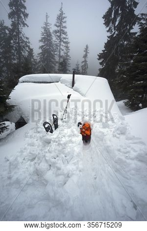 An Avalanche Mountain Shelter In The American Mountains. Alpine Lifeguards Dig Up The Entrance To A