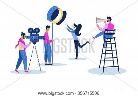 Actress Playing Role At Videocamera And Lighting Equipment. Film Director With Megaphone Sitting On