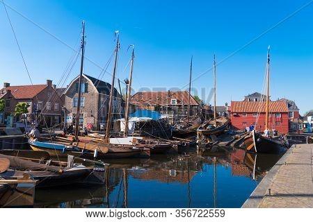 Spakenburg, Netherlands - May 8, 2018: Dry Dock In The Harbor. Spakenburg Has Always Been A Fishing