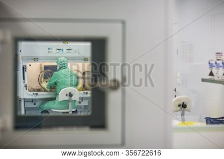 Virus antidote being prepared in a biochem lab with extremely strict precautionary measures (shallow DOF; color toned image)