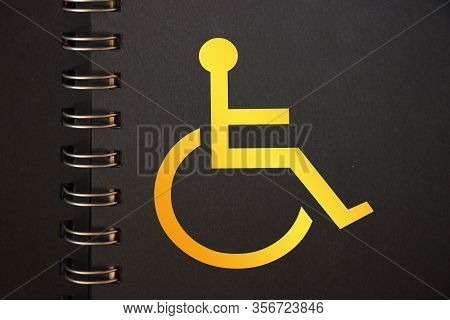 Disabled Icon Yellow In Black Copybook. Disabled People Equal Rights Diversity Program Copcept