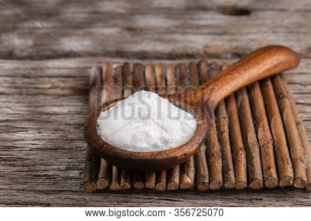 Baking Soda On Wooden Background, Space For Text