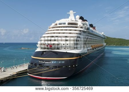 The View Of A Cruise Ship Moored To The Pier Of St. Thomas Island (u.s. Virgin Islands).