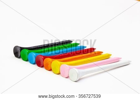 Golf Set - Ball With Tees. Golf Tees In The Rainbow Colors.