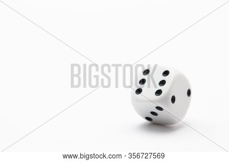 White Dice On The White Table. Playing Dice At White Wooden Background. Playing A Game With Dice. Ri
