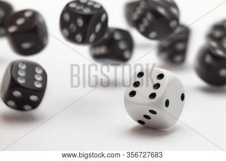 Black And White Playing Dice At White  Background. Playing A Game With Dice. Rolling The Dice Concep