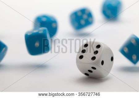 Blue And White Playing Dice At White  Background. Playing A Game With Dice. Rolling The Dice Concept