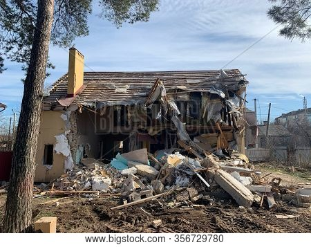Ruined, Brick, Residential Building. The Ruins Of A Collapsed Mansion In The Forest. Demolition Of A