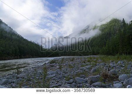 Low Clouds On The Mountainside. The Oka Sayan River In The Orkho-bom Gorge. East Sayan, Buryatia, Si