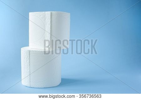 Two Toilet Paper Roll On A Blue Background Top View. Toilet Paper Purchase Due To Kronavirus Concept