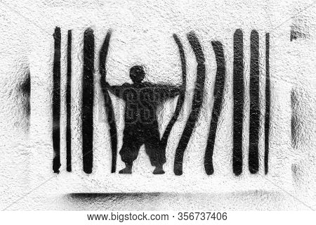 Graffiti Depicting A Man Escaping From Prison. Concept Of Escape, Protest Against The System. Power