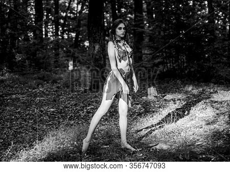 Female Spirit Mythology. Wild Woman In Forest. Sexy Girl Early Stage In The Evolutionary Development
