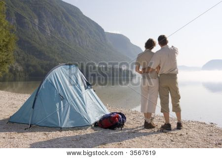 Couple Beside A Tent At A Mountain Lake