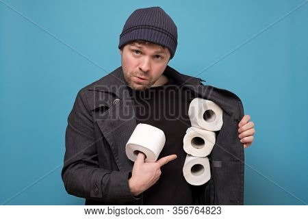 Speculator Man Holding Several Roll Of Toilet Paper. Do You Want To Buy It