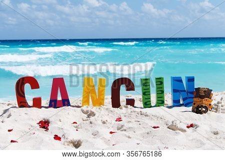 Cancun. Inscription On The Beach Playa Delfines.