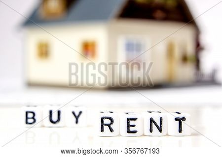 The Decision About Rent Or Buy A New Residence As An Investment Oportunity, A Team Of Miniature Figu