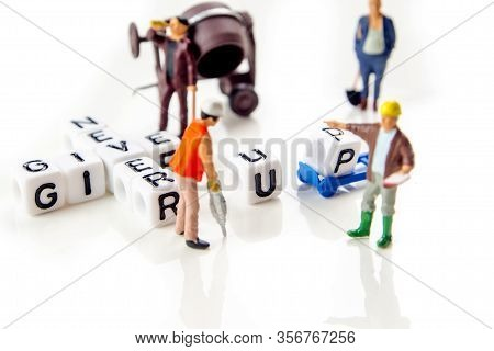 Never Give Up Quote Formed Of White Dices With Black Letters And Green Little Miniature Figurines Of