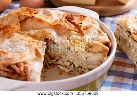 Homemade Pie With Cheese And Herbs In A Baking Dish
