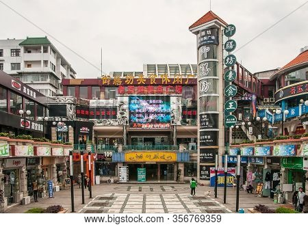 Guilin, China - May 10, 2010: Downtown Zhengyang Pedestrian Road. Shopping Mall And Square With 2 Le