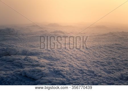 A Misty Winter View With The Sun Rising From Behind The Fog