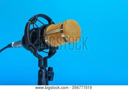 Studio Microphone For Recording Podcasts, Songs, And Radio Programs On A Blue Background With A Plac